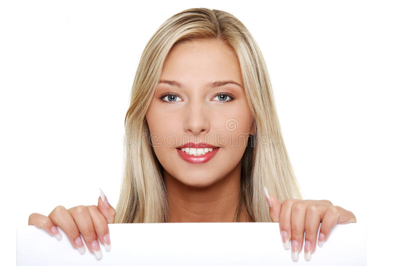 Young woman holding a blank signboard. stock photo