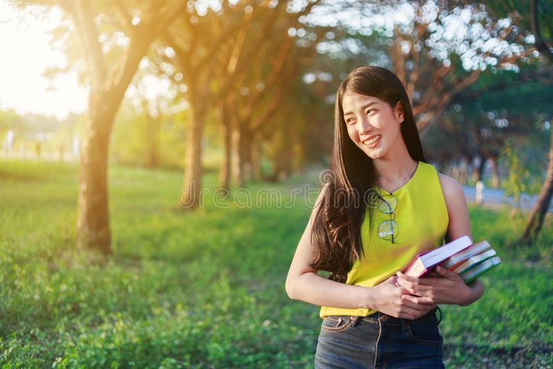 Woman holding with a book in the park stock photos