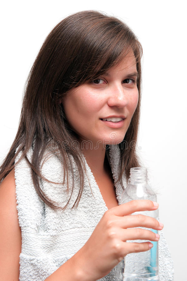 Young woman holding bottle of water royalty free stock photo