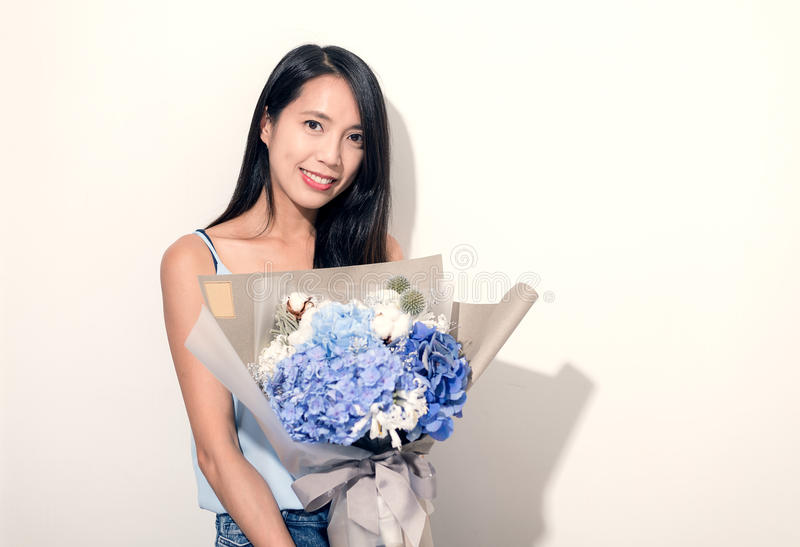 Young Woman holding bouquet of flower. Asian young woman portrait stock images