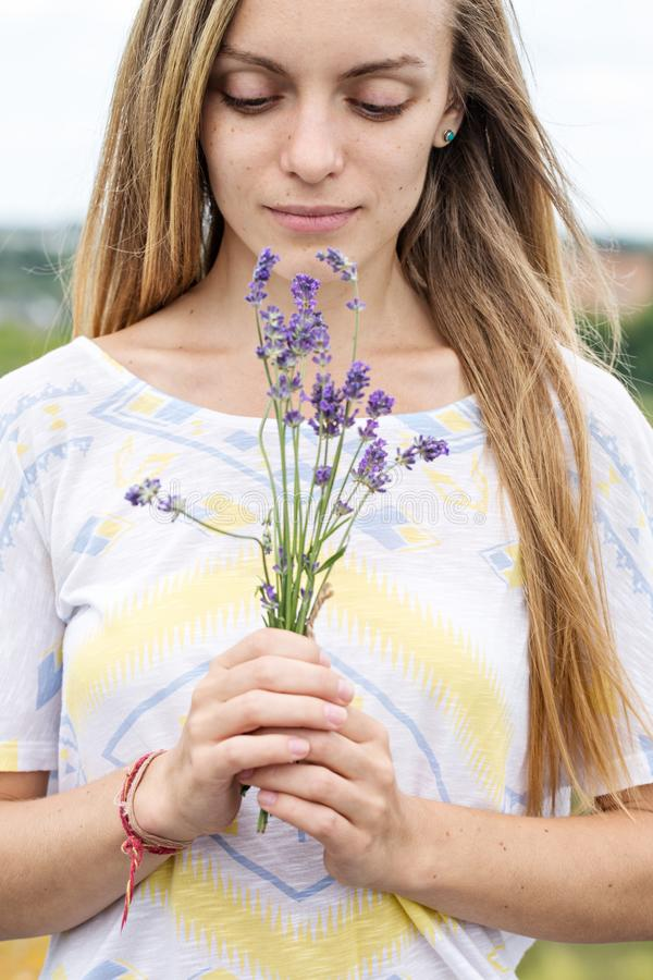 Woman holding a bouquet of lavender, close-up stock photography
