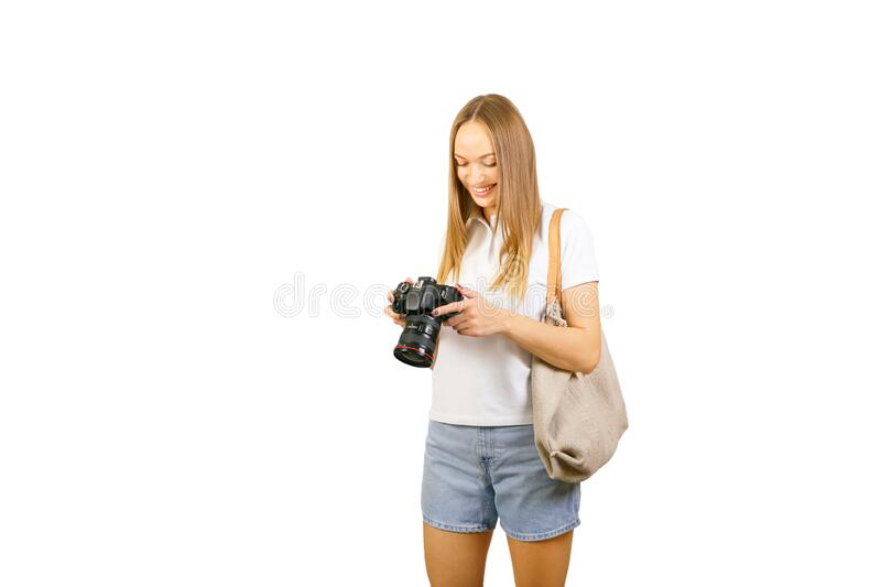 Young woman, holding a  camera. Happy Young woman, holding a  camera on white background royalty free stock image
