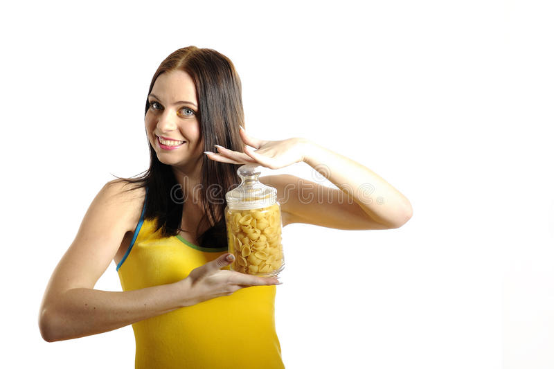Young woman holding canes with different pasta stock images