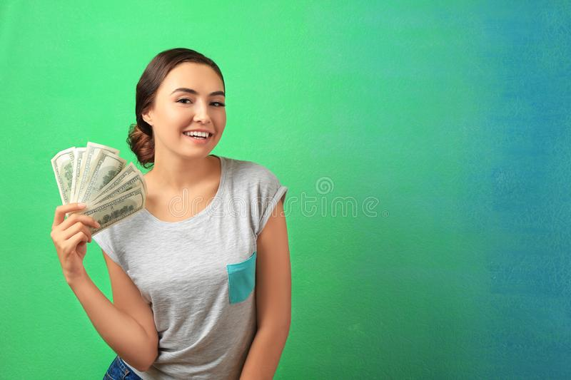 Young woman holding cash royalty free stock photo