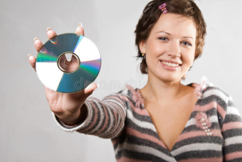 Young woman holding CD disk stock photos