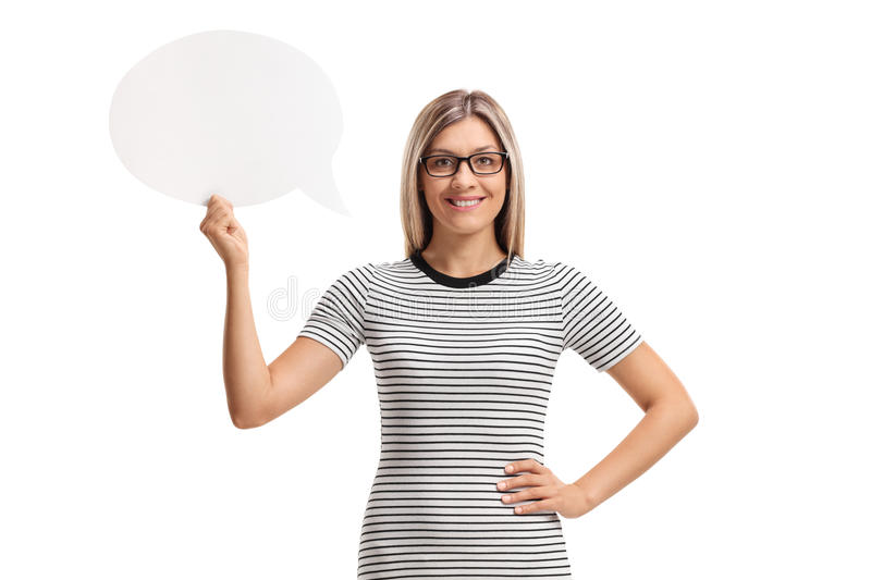 Young woman holding a chat bubble and smiling stock images