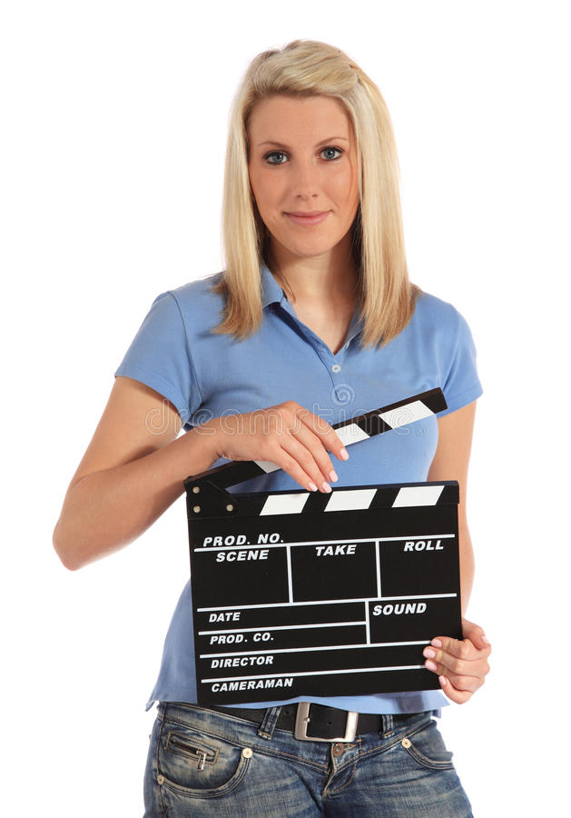 Young woman holding clapperboard stock photos