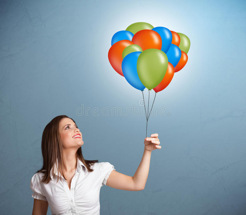 Download Young Woman Holding Colorful Balloons Stock Photo - Image: 28063208