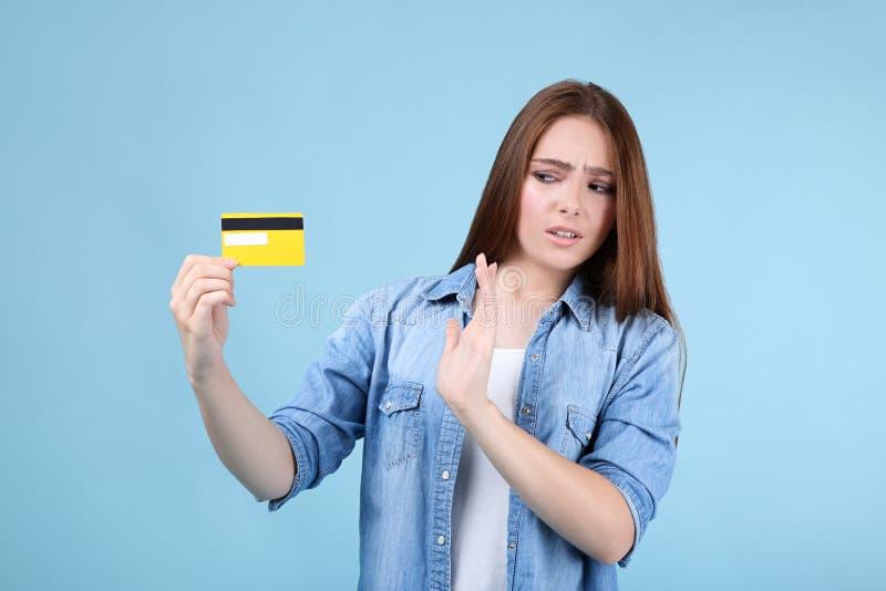 Woman holding credit card stock photos