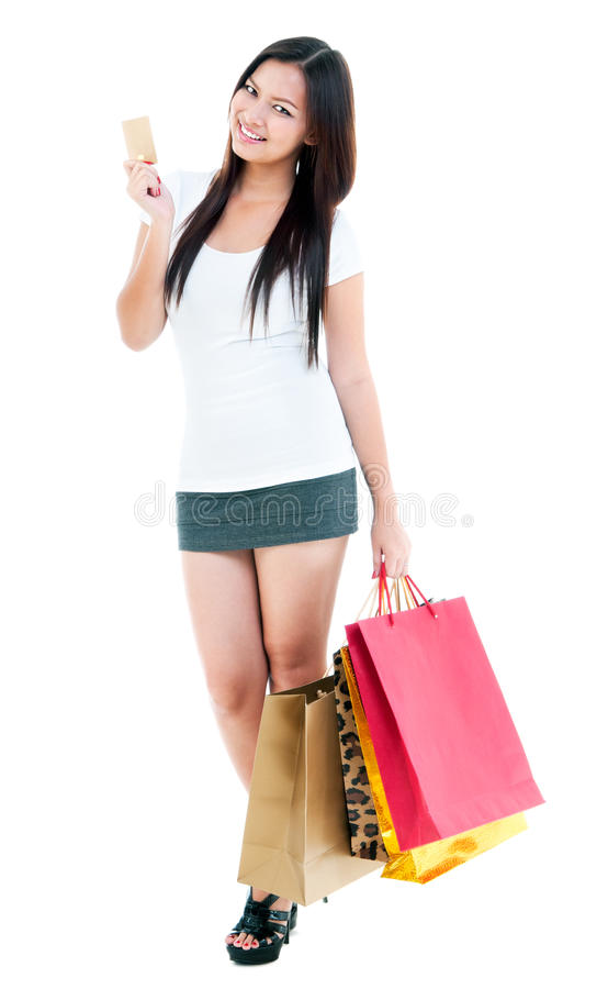 Download Young Woman Holding Credit Card And Shopping Bags Stock Photo - Image: 26070870