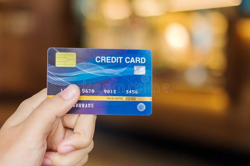 Young woman holding credit card  for shopping.business, lifestyle,technology,ecommerce and online payment concept royalty free stock images