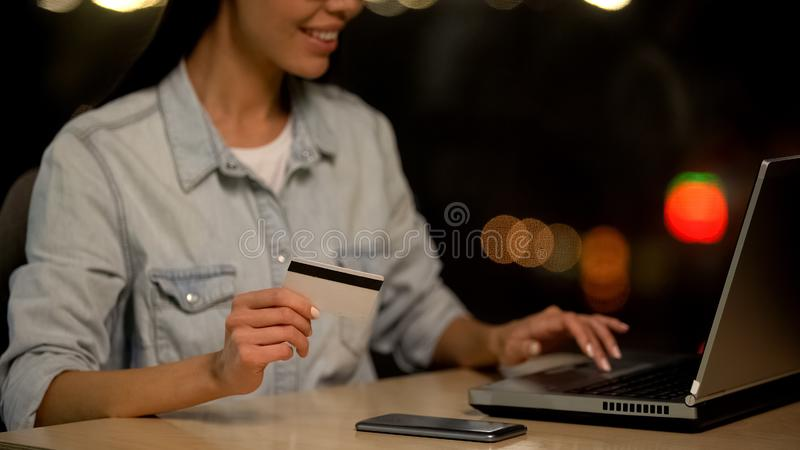 Young woman holding credit card shopping on laptop, online deposit, transaction. Stock photo stock photos