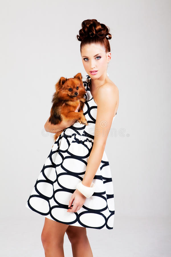 Download Young Woman Holding Dog stock photo. Image of portrait - 14277426