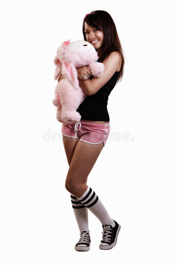 Young woman holding doll royalty free stock photo