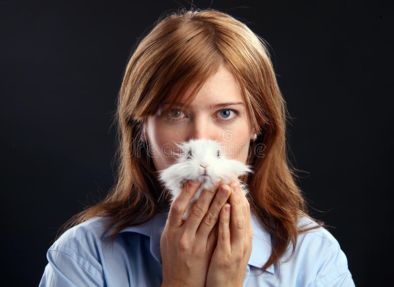 Young woman holding domestic rabbit stock images