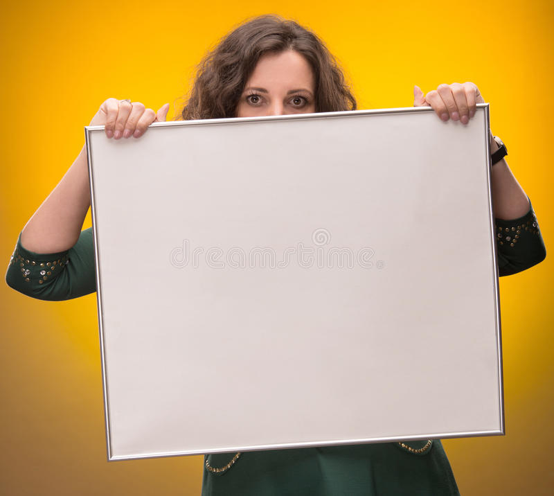 Download Young Woman Holding Empty Billboard Stock Photo - Image: 29608778