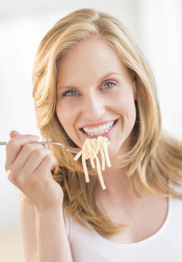 Download Young Woman Holding Fork With Pasta At Home Stock Image - Image: 34263463