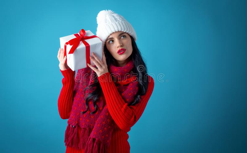 Young woman holding a gift box stock images