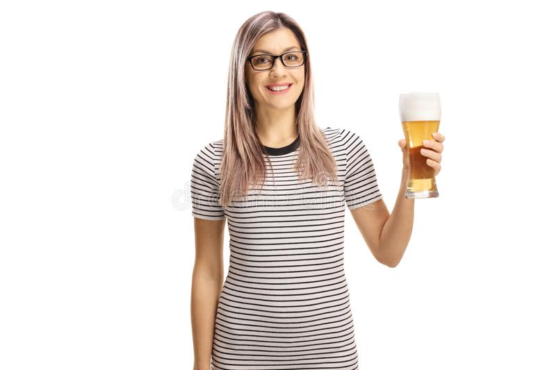 Young woman holding a glass of beer stock photos