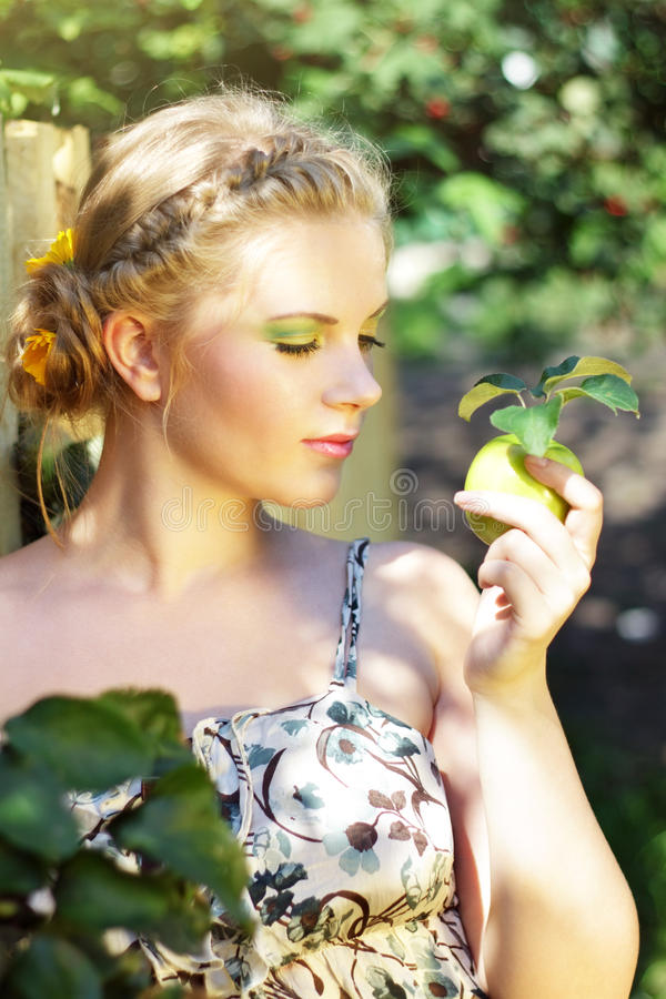 Download Young Woman Holding A Green Apple Stock Image - Image: 20798685