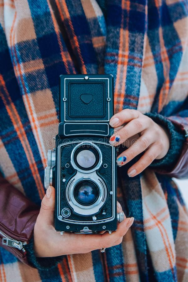 Young woman holding in hands old vintage camera. Girl photographer royalty free stock photos