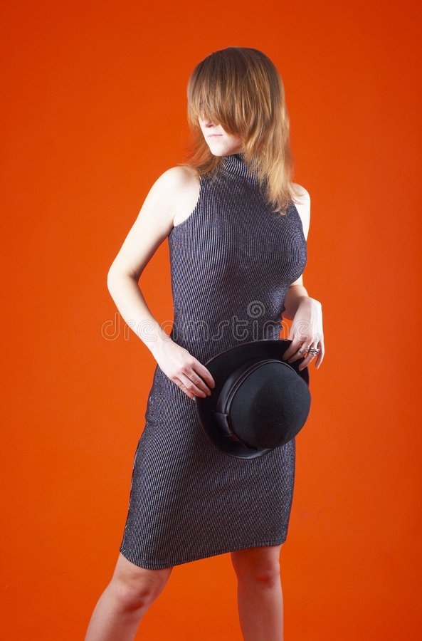 Young Woman Holding Hat royalty free stock photo