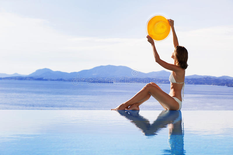 Download Young Woman Holding Hat Like A Sun Stock Photo - Image: 86247218