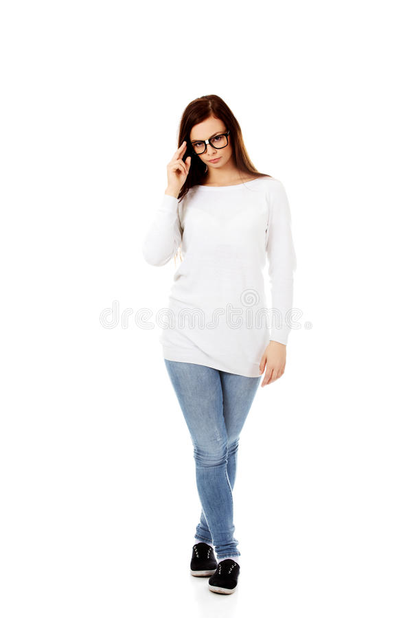 Young woman holding her glasses stock images