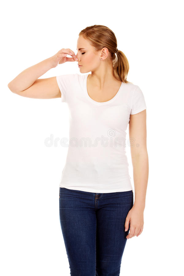 Young woman holding her nose because of a bad smell stock photos