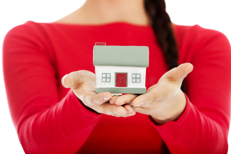 Young woman holding house model royalty free stock photography