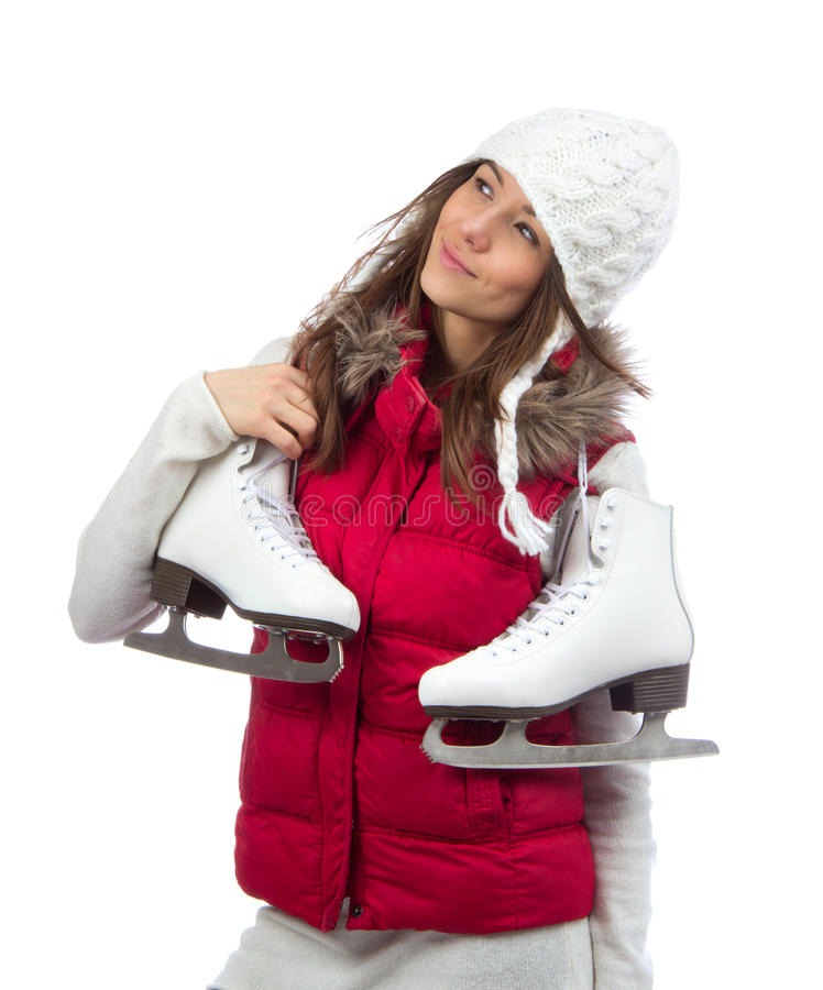 Young woman holding ice skates for winter ice skating