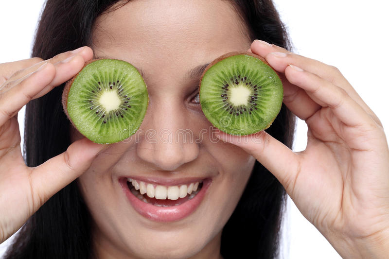 Young woman holding kiwi fruit stock images
