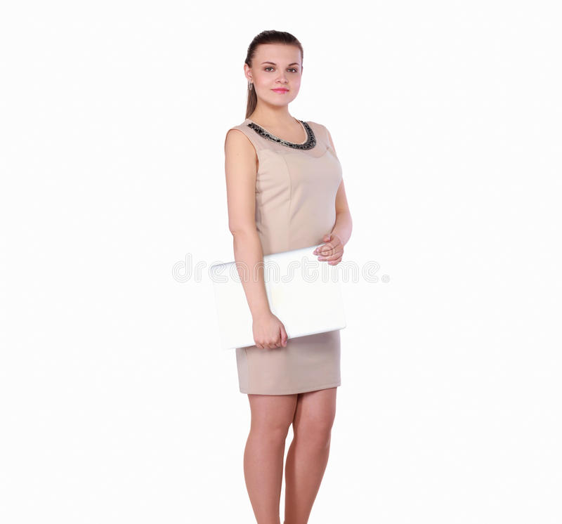 Young woman holding a laptop, isolated on white background. Portrait of young woman holding a laptop, isolated on white background stock image