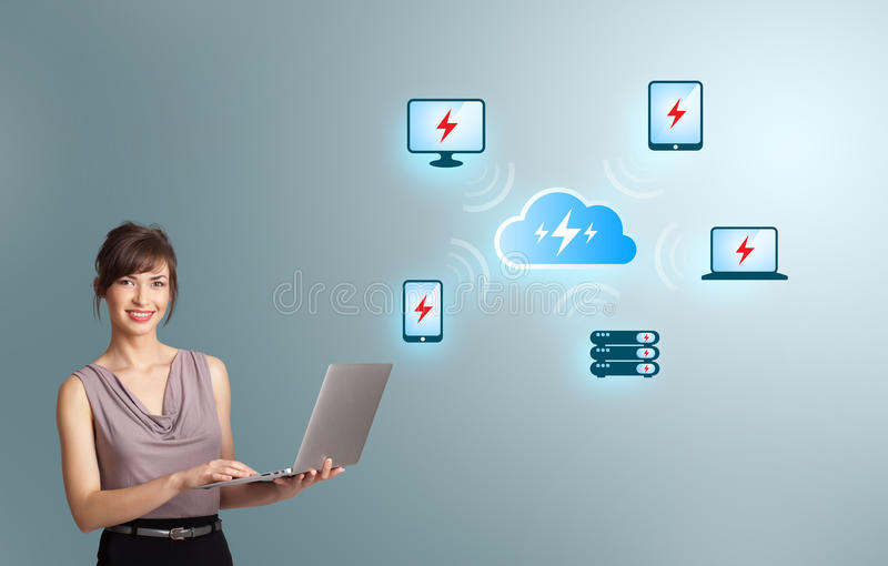 Young woman holding a laptop and presenting cloud computing network. Beautiful young woman holding a laptop and presenting cloud computing network royalty free stock photos