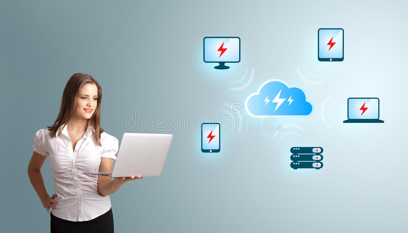 Young woman holding a laptop and presenting cloud computing network. Beautiful young woman holding a laptop and presenting cloud computing network stock photos