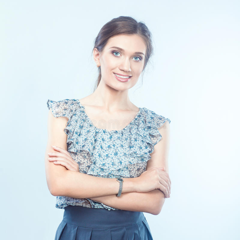 Young woman holding a laptop, standing on gray background.  stock photos