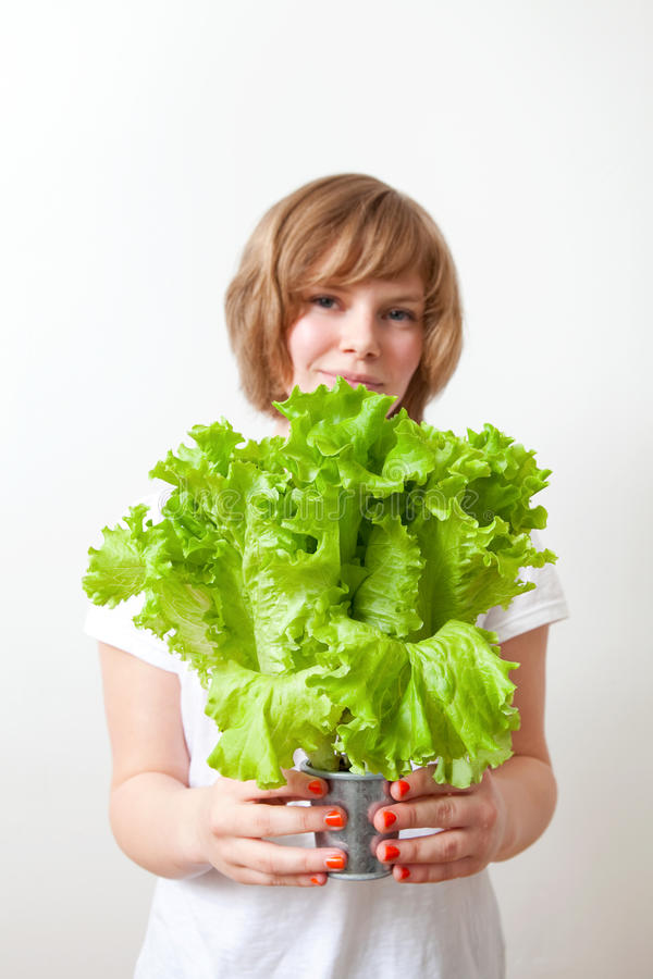 Download Young Woman Holding Lettuce Stock Image - Image: 20588653