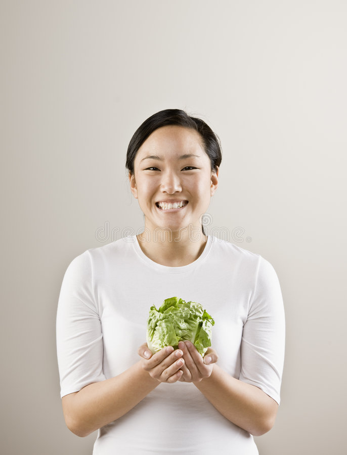 Download Young Woman Holding Lettuce Stock Image - Image: 5390555