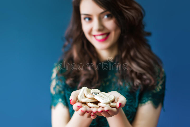 Young woman holding a lot of usb sticks. Young woman holding a lot of wooden usb sticks in hands royalty free stock image