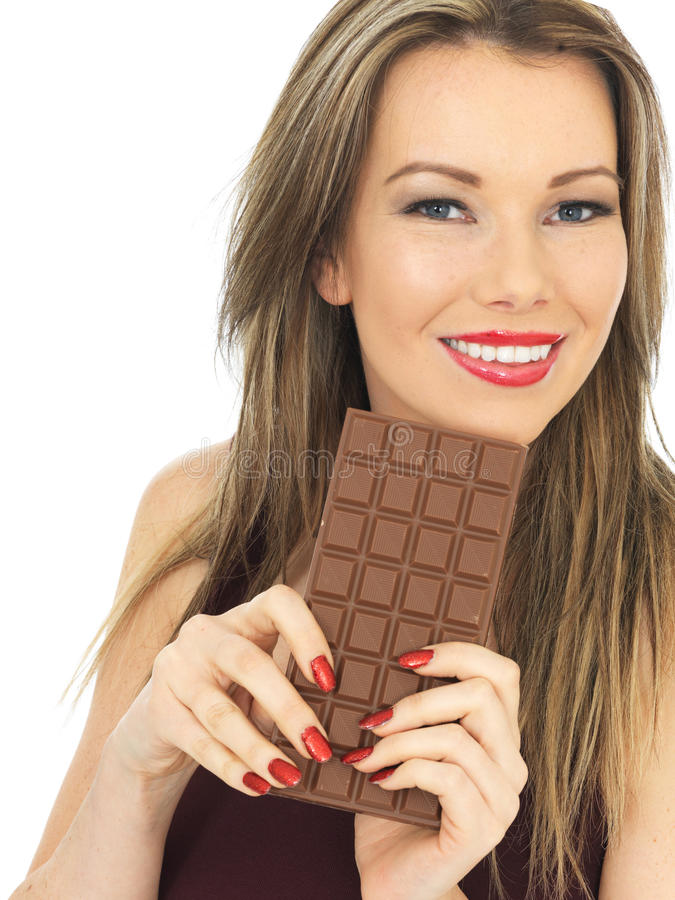 Young Woman Holding a Milk Chocolate Bar royalty free stock photos