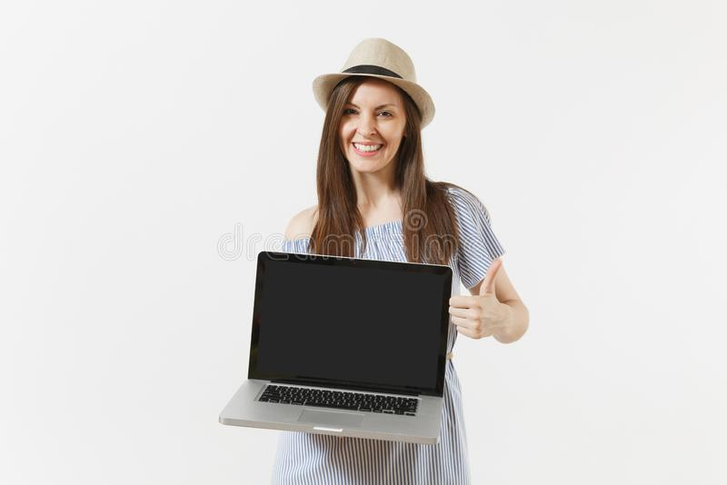 Young woman holding modern laptop pc computer with blank black empty screen to copy space isolated on white background royalty free stock photos