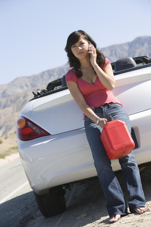 Young Woman Holding Oil Can stock photography