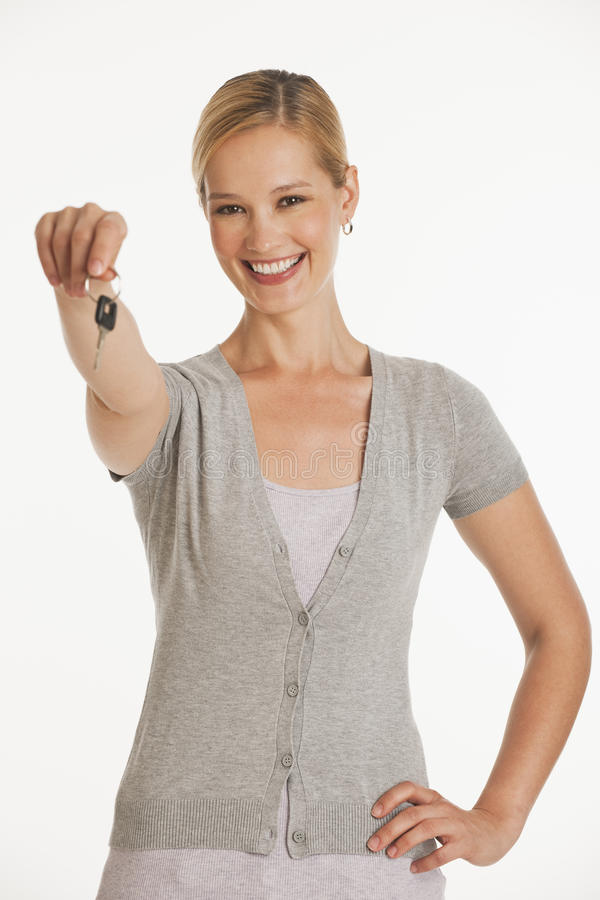 Download Young Woman Holding Out Keys Towards Camera Stock Photo - Image: 10353892