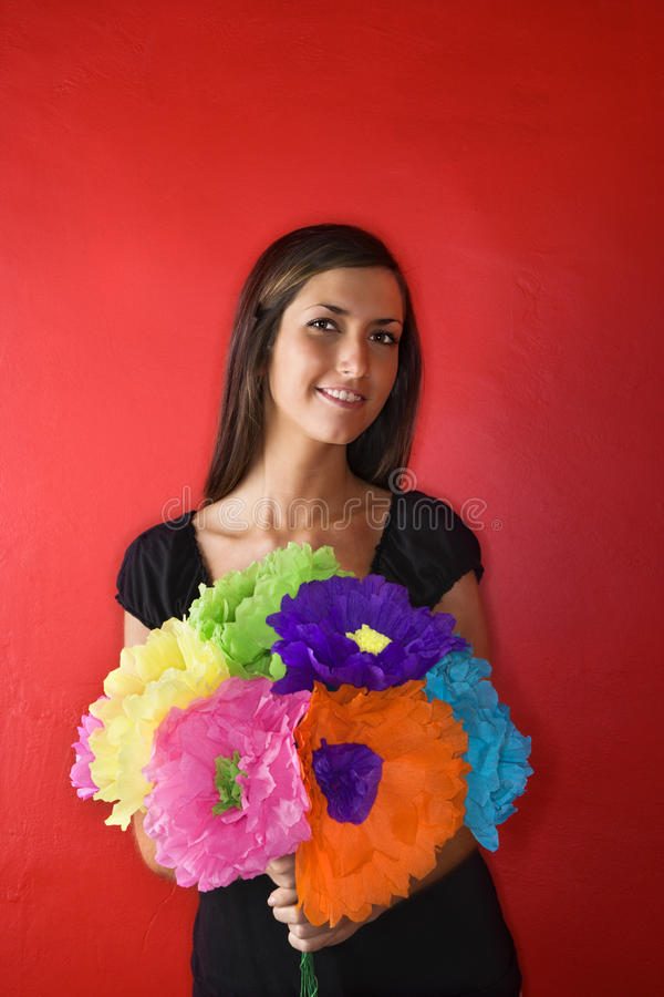 Young Woman Holding Paper Flowers. Isolated royalty free stock photography