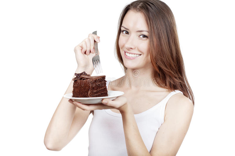 Young woman holding piece of chocolate cake stock images