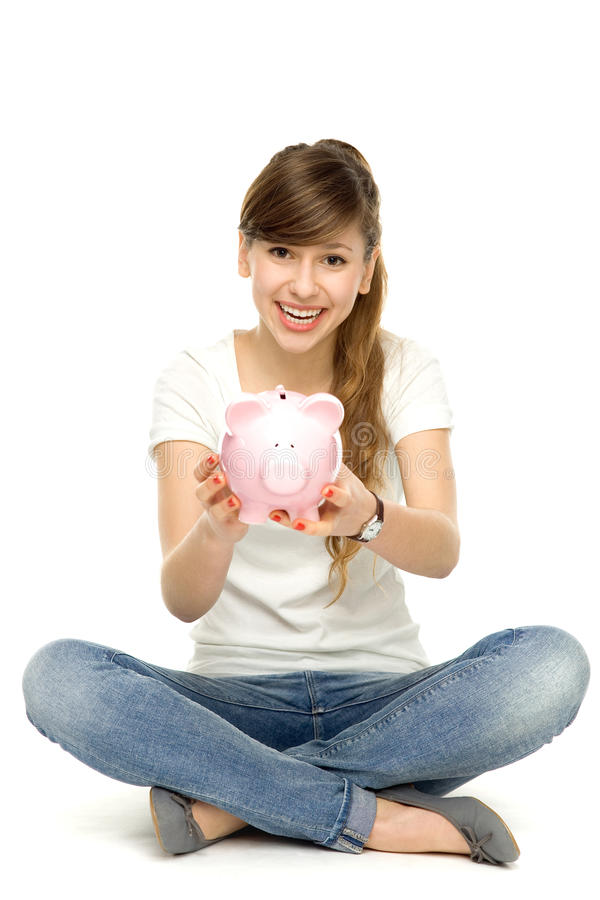 Download Young Woman Holding Piggybank Stock Photo - Image: 22901540