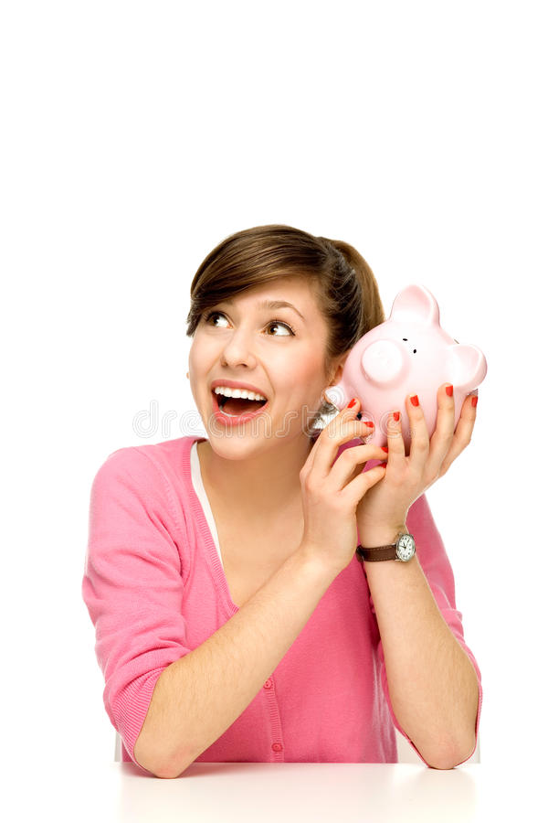 Download Young Woman Holding Piggybank Stock Image - Image: 23112821
