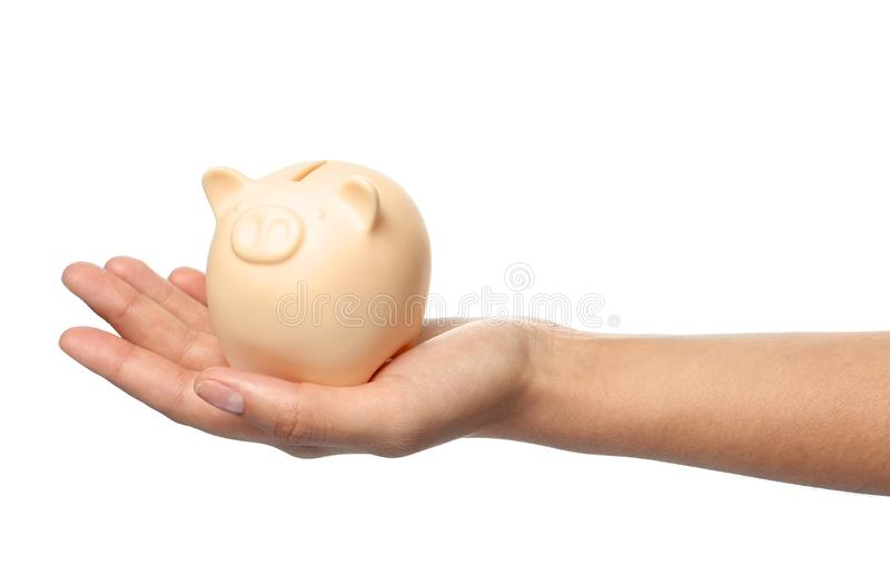 Young woman holding piggybank on white background. Closeup view stock images
