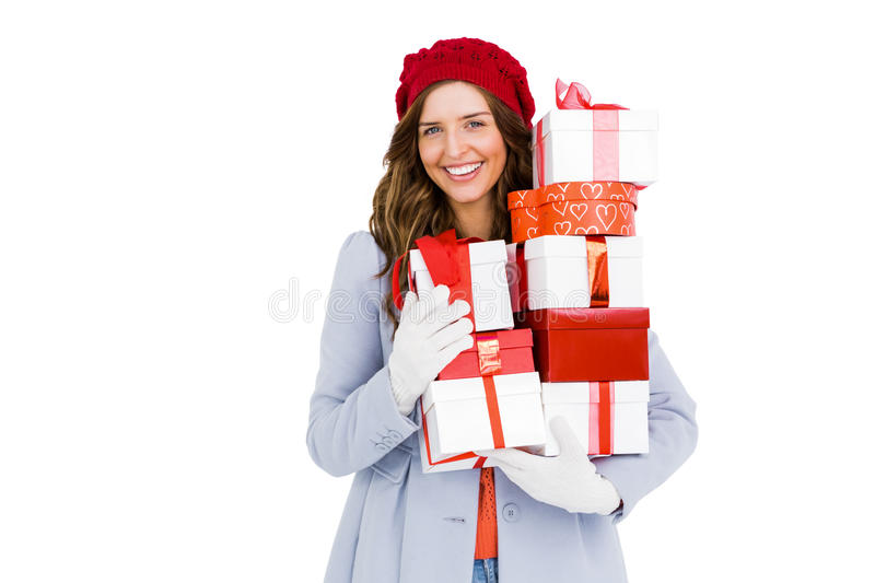 Young woman holding pile of gifts stock photo