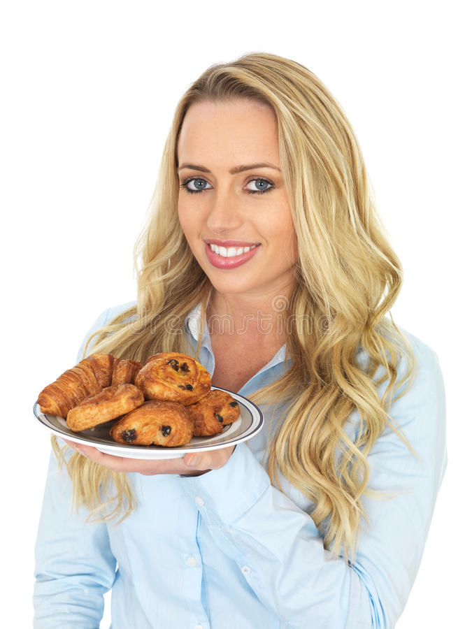 Young Woman Holding a Plate of Mixed Danish Pastries. Attractive Young Woman, with long blonde hair in her twenties, holding or maybe offering a plate of mixed royalty free stock images